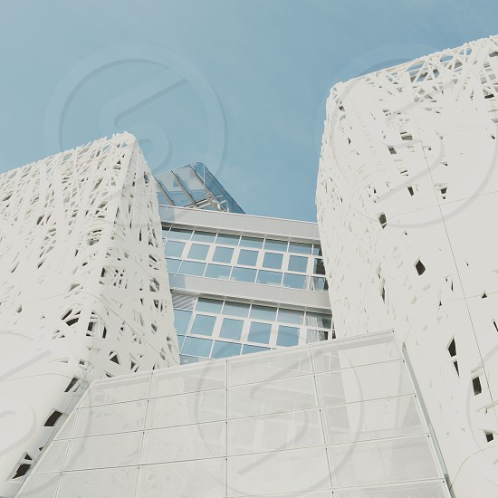 white concrete landmark outdoors under blue and white sunny cloudy sky during daytime photo
