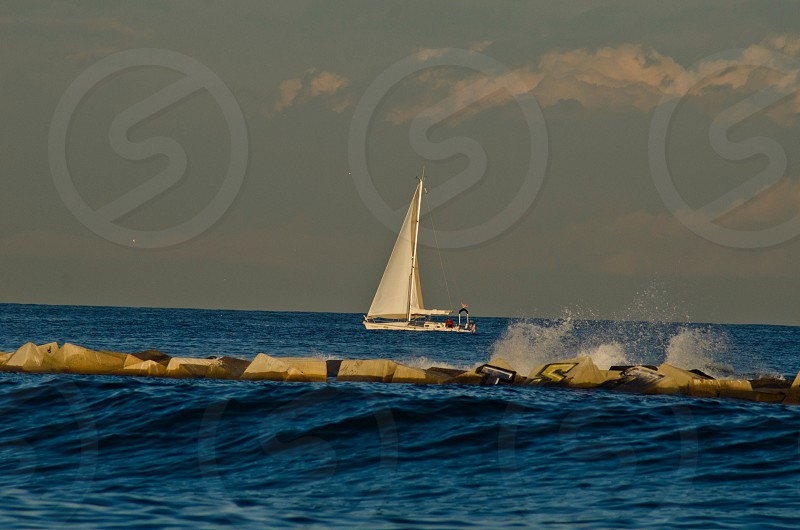 view of the white sailboat on sea photo