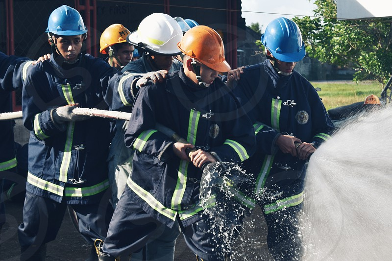 A group of fire fighters in action photo