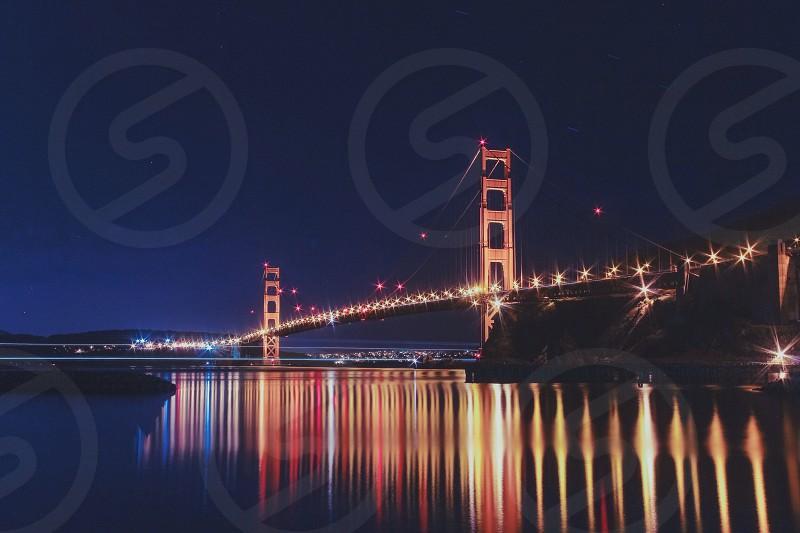 view of golden gate bridge at night photo