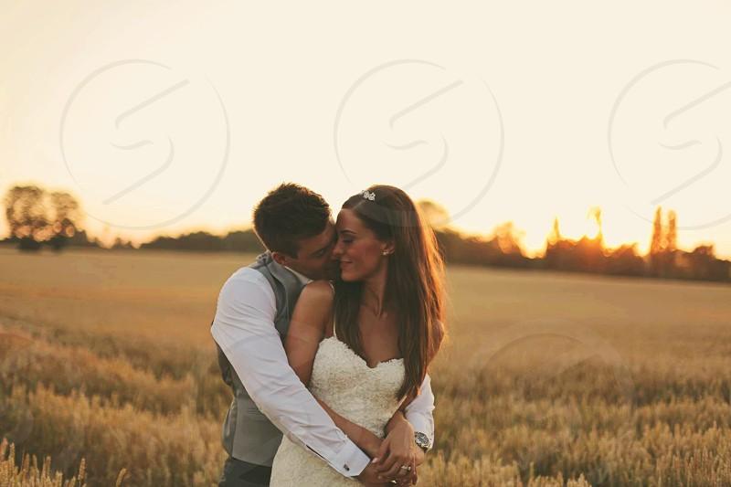 Beautiful wedding couple in sunset #sunset #wedding #goldenhour #couple #married  photo