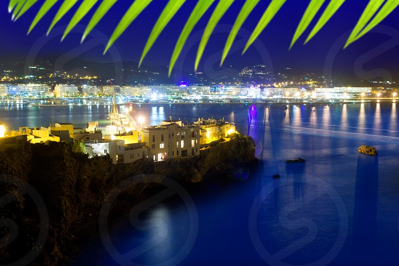 Ibiza town port blue sea night lights of Eivissa city photo
