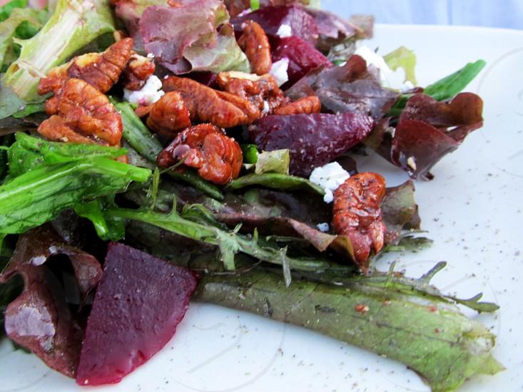 Beet and pecan green salad photo