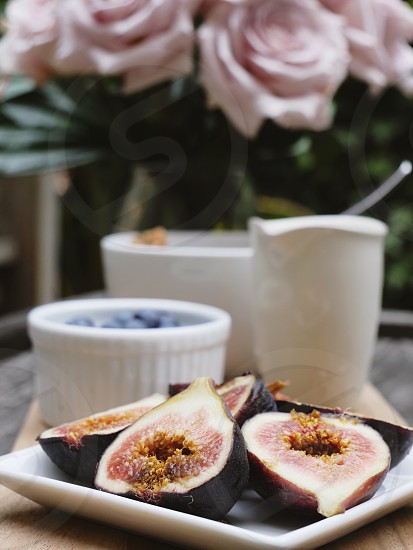 Fresh figs healthy eating organic breakfast food pink and white rustic table setting  photo