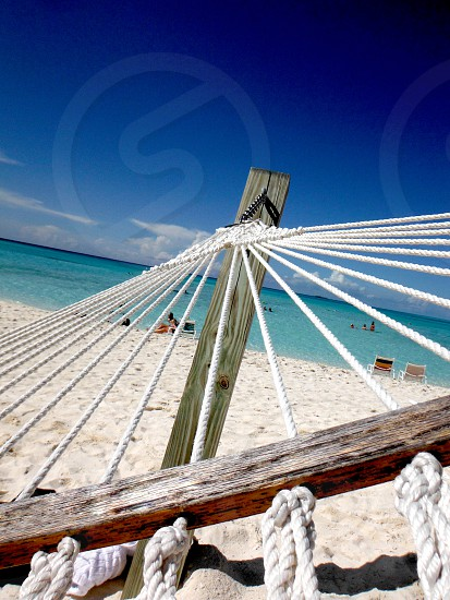 Relaxing in a hammock on a beach in the Bahamas photo