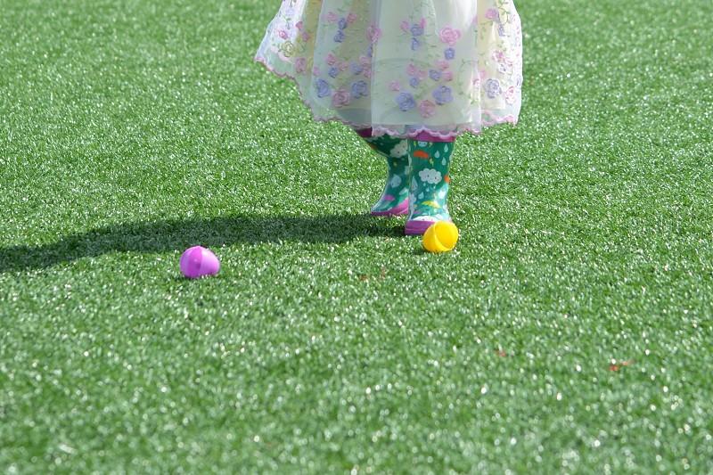 Easter egg hunt plastic eggs rain boots dress child toddler girl photo