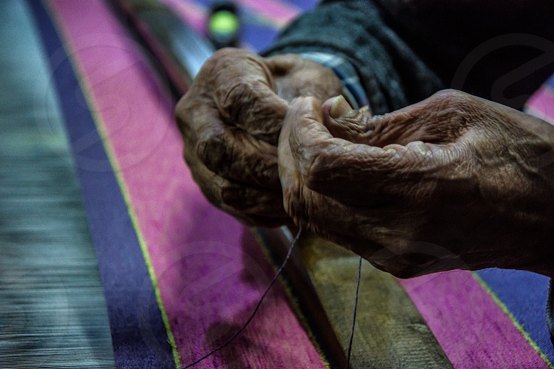 weaving hands old hand working artisan handwork colorful photo