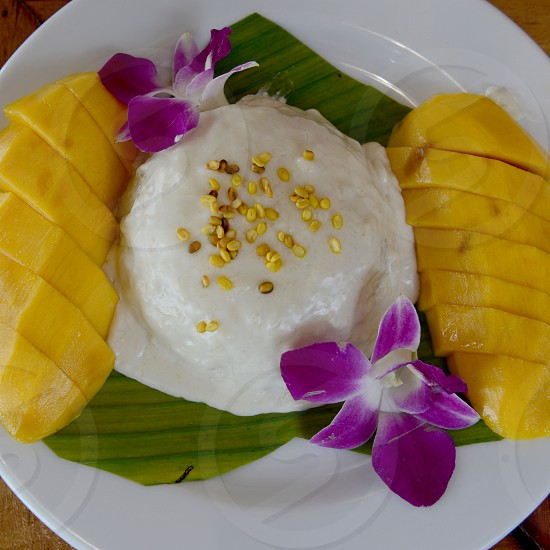 a Thai desert rice with mango in a restaurant at the Hat Railay Leh Beach at Railay near Ao Nang outside of the City of Krabi on the Andaman Sea in the south of Thailand.  photo