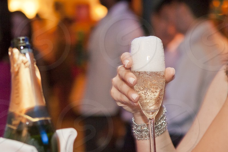 champagne glass woman hands party wedding photo