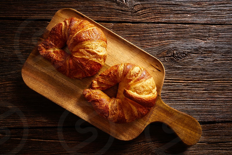 Croissants in a wooden board table photo