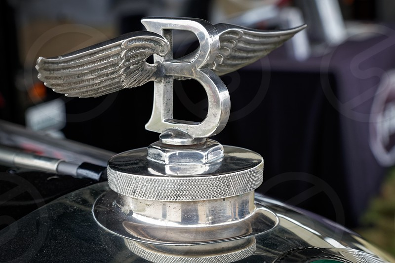 Close-up of an old Bentley badge photo