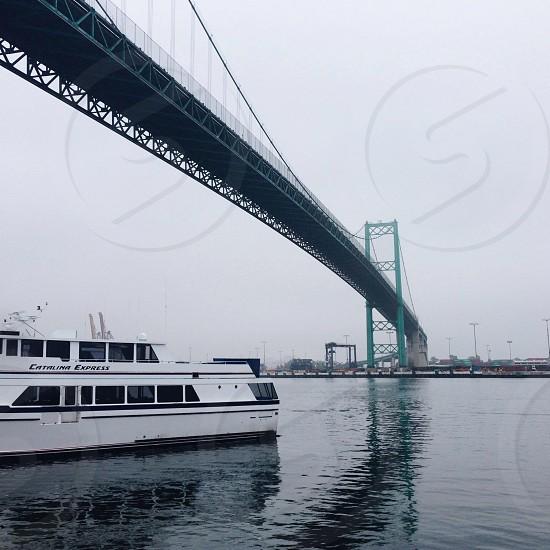 white boat under golden gate bridge photograph photo