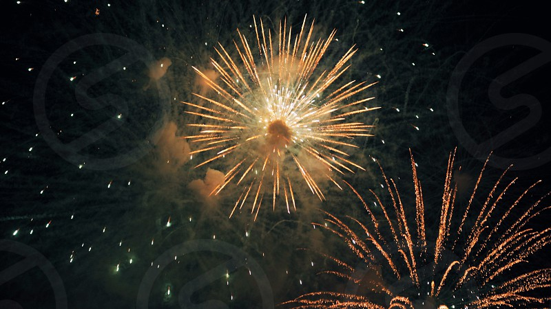 Colorful Spectacular multiple fireworks at holiday New Year celebration night photo