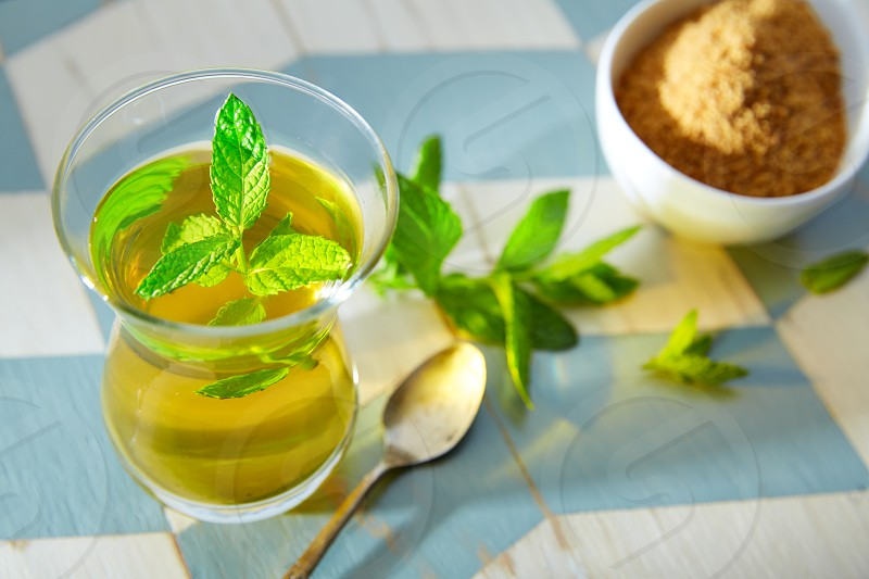 green tea with mint Moroccan style on wood blue white table photo