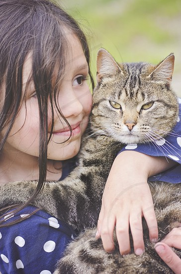 girl hugging cat photo