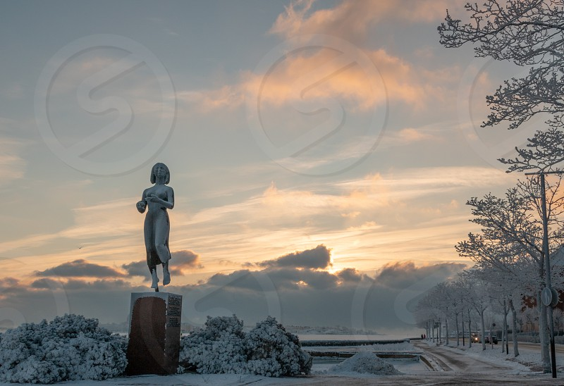 HELSINKI FINLAND - January 08 2015: The Rauhanpatsas (Statue of Peace) in Helsinki Finland in the winter with snow photo