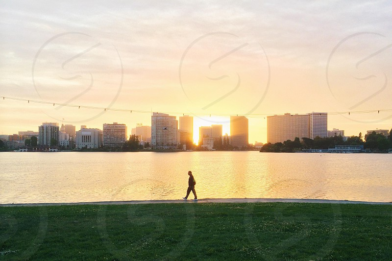 man walking near the water photo
