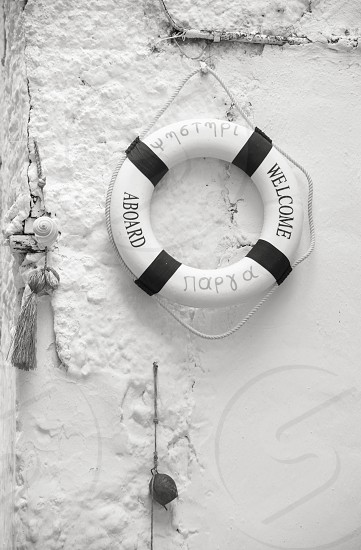 Lifebuoy With Welcome Aboard Message Hanged On The Wall In Parga Greece photo