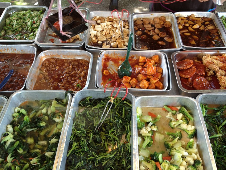 displayed foods in grey stainless steel trays photo