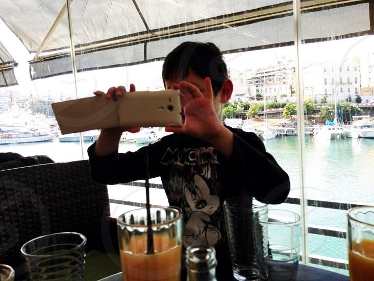 Child boy using technology smartphone camera photo