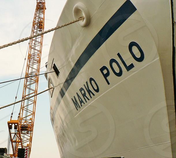marko polo white ship beside yellow crane at daytime photo