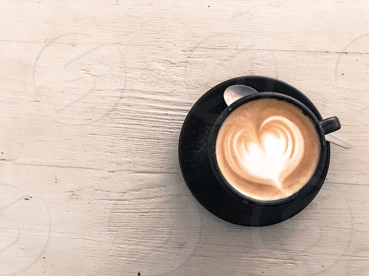 Heart cappuccino coffee latte art love white drink cup coffee lover photo
