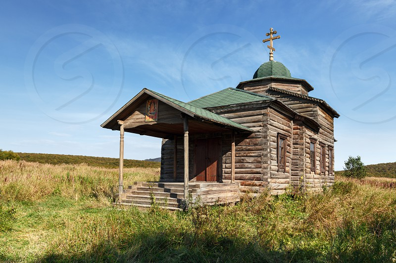 KAMCHATKA RUSSIA - SEP 19 2015: View on ancient wooden Orthodox Church of the Assumption (Church of the Dormition). The church is located in the former settlement Nizhnekamchatsk built in 1864. photo