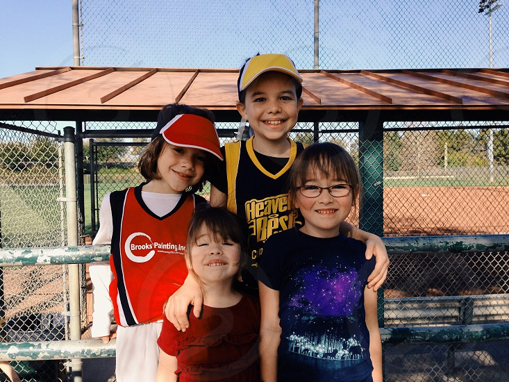 group of girls in front of chain link fence smiling photo