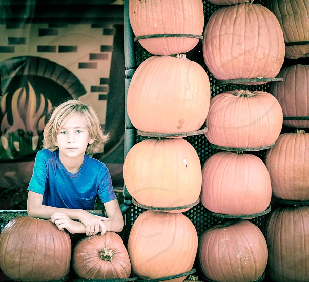 Boy portrait pumpkin patch window youth blonde blue photo