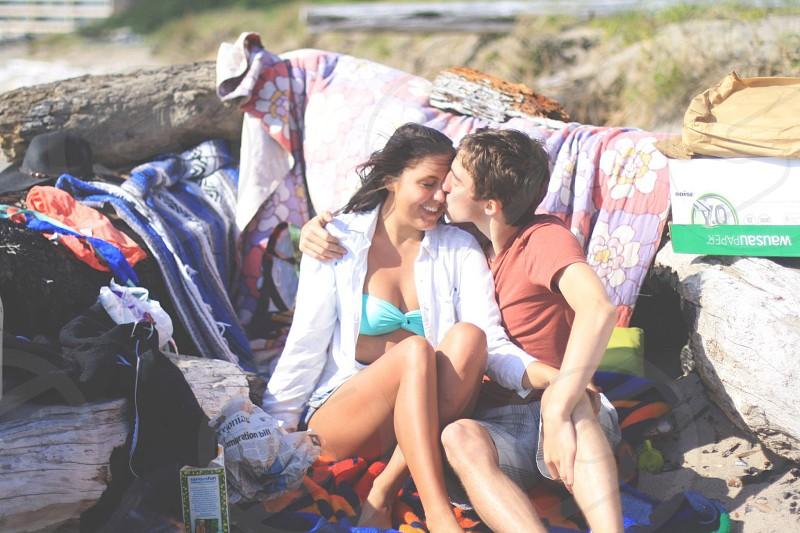 Happy couple on beach date photo