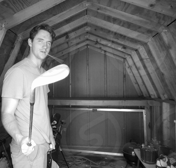 My friend Willy in a shed threatening me with a golf club. photo