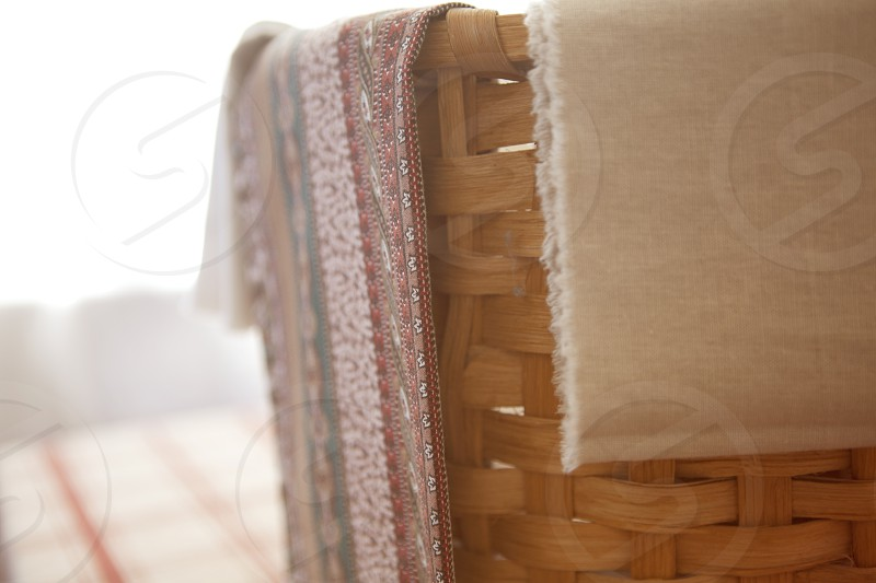 brown woven basket with textile photo