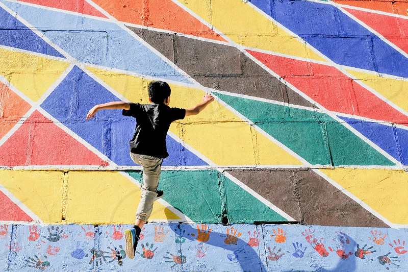 A boy running up a wall photo