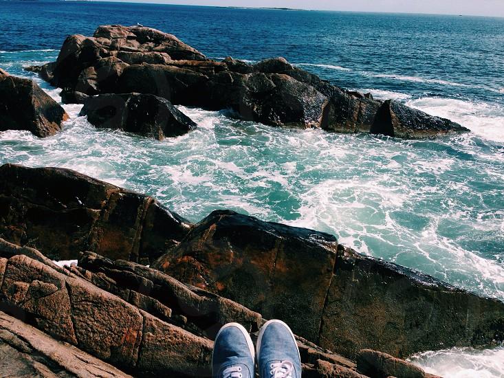 Rocks beach ocean shoes photo