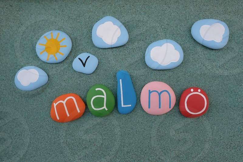 Malmö  Skåne County the third-largest city in Sweden creative souvenir composed with multi colored stones over green sand photo