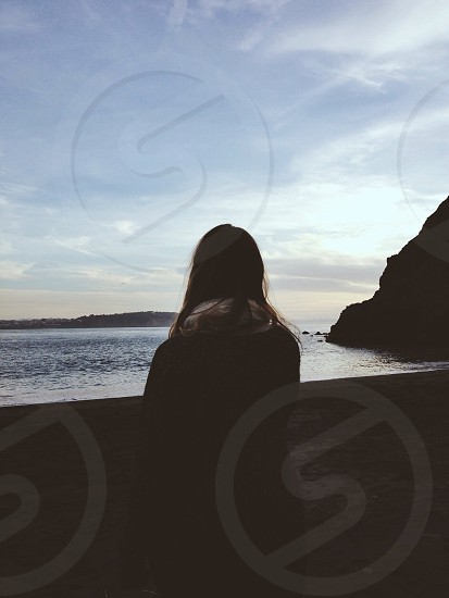 Silhouette of girl at beach. photo
