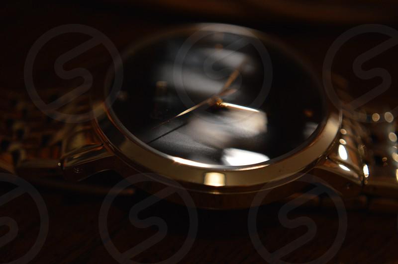 gold and black round analog watch photo