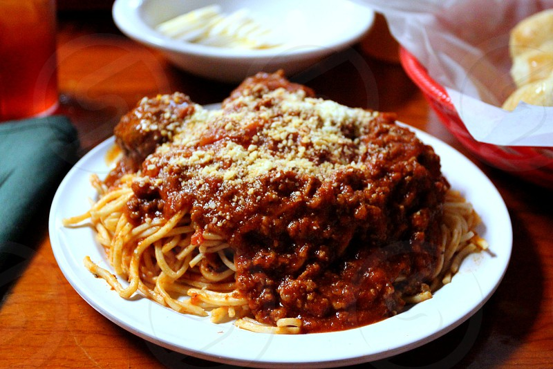 Plate of spaghetti with meat sauce Parmesan cheese (example from Venesian Inn Tontitown AR) photo
