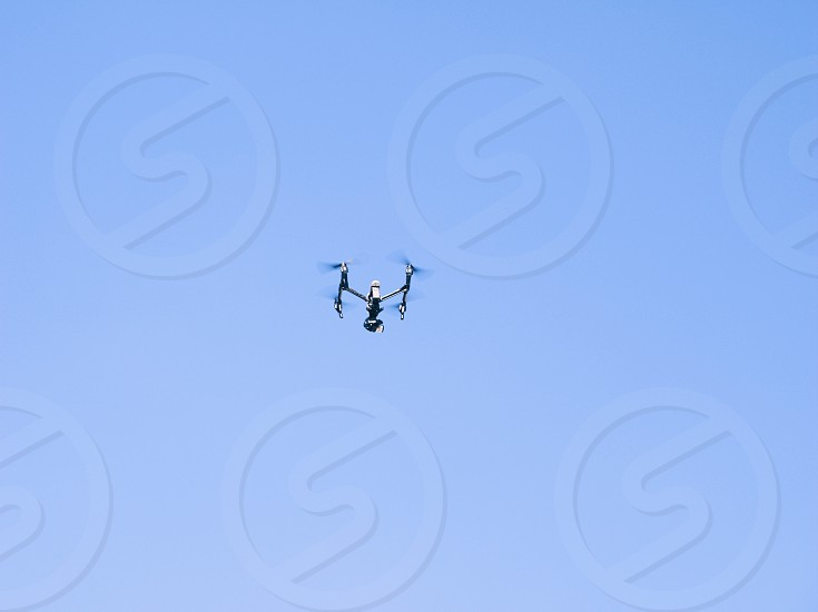 Drone in Operation on the Clear Blue Sky photo