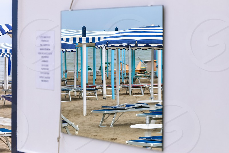 Beach in the reflection of the mirror Italy Riccione photo