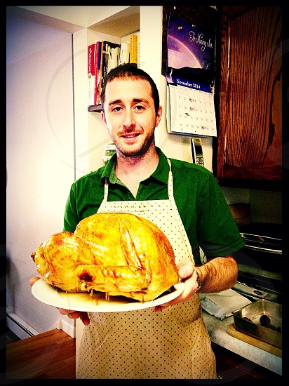 man holding plate with cooked turkey photo