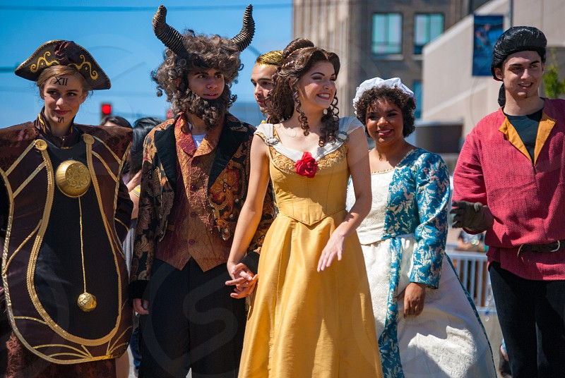 group of actors dressed up as characters from Beauty and Beast photo