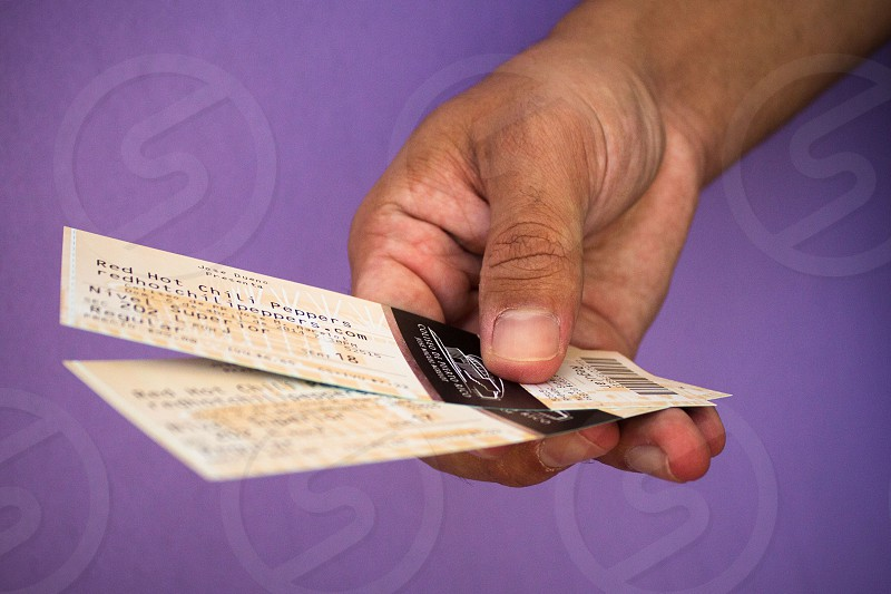 person holding paper tickets photo