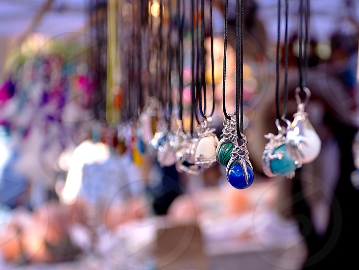Indian colorful necklaces on street market. photo