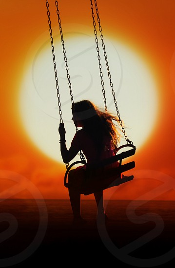 woman on swing silhouette photo