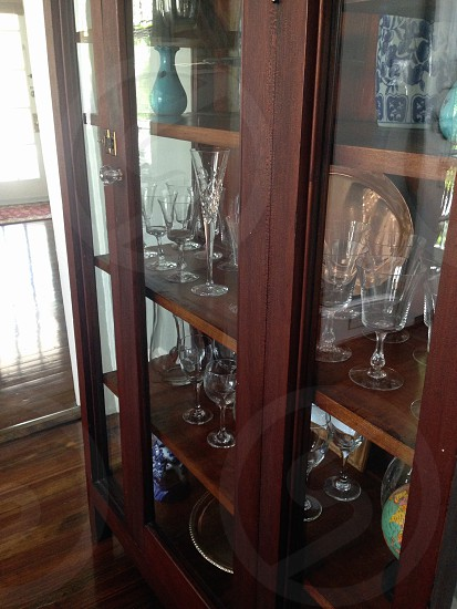 glasses inside glass cabinet photo