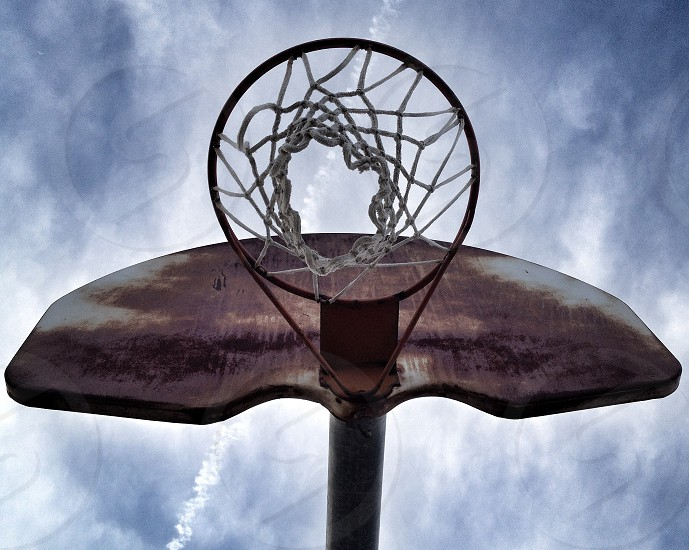 brown and gray metal basketball ring in low angle photography photo