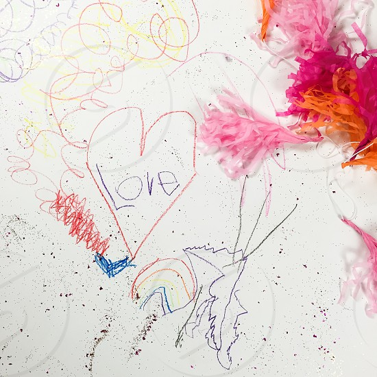 Kids art artwork creative messy colored pencils glitter sparkles rainbow heart garland love photo