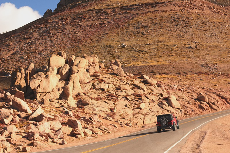 Jeep car vehicle road drive rocks driving red Colorado outside pikes peak photo