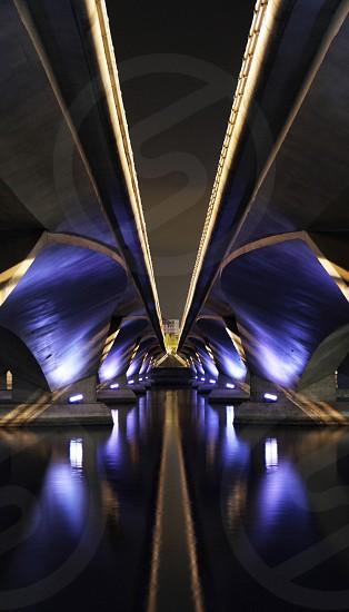 Under a Bridge in Singapore @ night. Long exposure.   photo